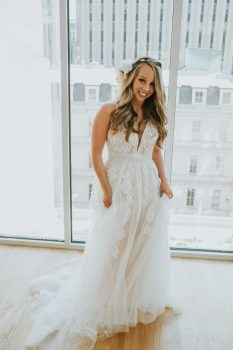 Bride in antique white wedding dress