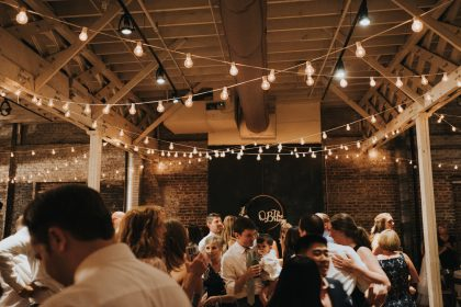 Dancing Under Market Lights in Urban warehouse wedding venue