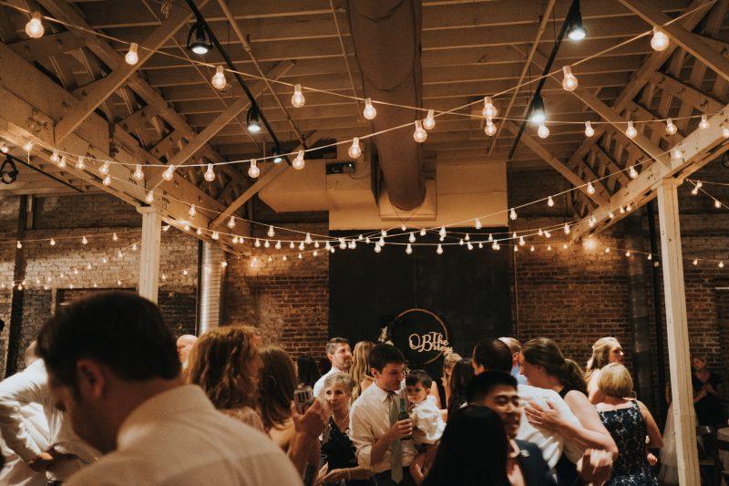 Dancing Under Market Lights in Urban warehouse wedding venue